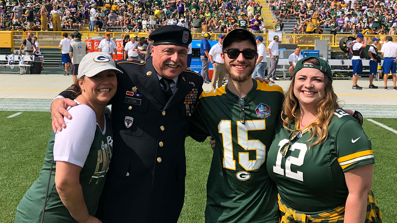 Warren Litza is shown on the field with his wife, Cyndi (left), son, Warren Litza II, and daughter, Samantha Litza.