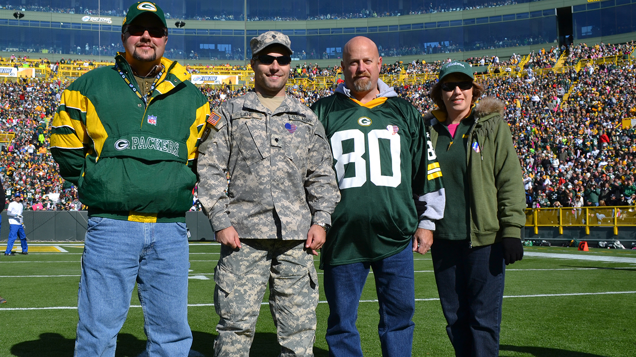 Accompanying U.S. Army Reserve Specialist Justin Lane to the game were his father, Art, his mother, Kristi, and his uncle, Wayne.