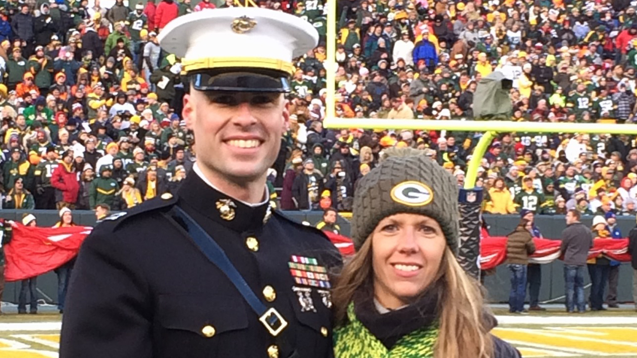 Marine Corps Captain Brandon Mills and his wife, Nora, are shown at Lambeau Field for the Operation Fan Mail ceremony.
