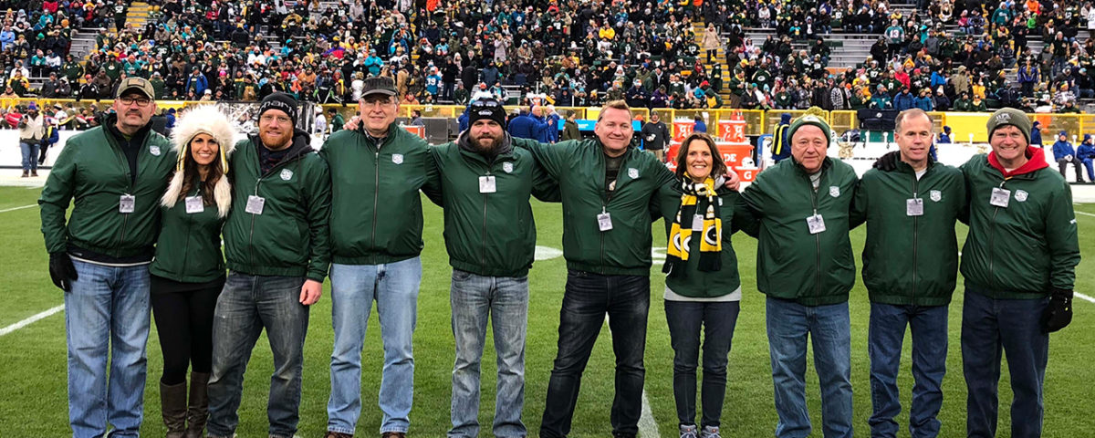 Veterans honored for Operation Fan Mail at Lambeau Field on Sunday are, left to right: Kevin and Kim Galske, Mike Daniels, Andy Kirkpatrick, Dan Tinsley, Timothy La Sage, Jo-Ann and Boyd Decker, Mike Jonasson, and Rob Palmer.